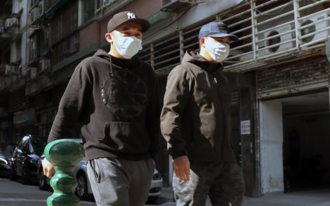 men in masks in macau